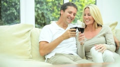 Caucasian Couple at Home Drinking Red Wine Stock Footage