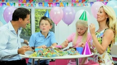 Attractive Caucasian Family Enjoying Birthday Cake Stock Footage