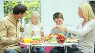 Stock Video Footage of Young Family Eating Healthy Meal