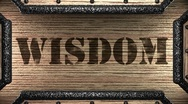 Stock Video Footage of wisdom on wooden stamp