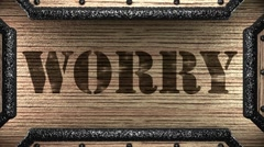 Worry on wooden stamp Stock Footage