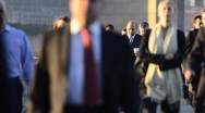 Stock Video Footage of London, Commuters crossing London Bridge