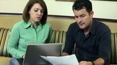 Couple going over bills Stock Footage