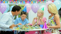 Young Caucasian Family Enjoying Birthday Cake Stock Footage
