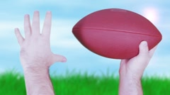 Football sky grass throw FREEZE Stock Footage