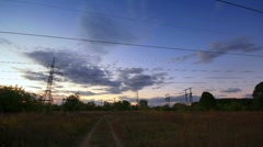 Powerlines in sunset. timelapse. Stock Footage
