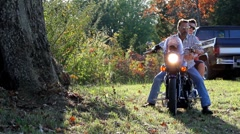 Slow motion motorcycle drive by with man and woman. Stock Footage