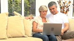 Mature Couple Having Success Online Stock Footage