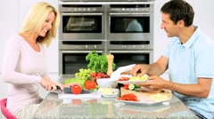 Young Couple Preparing Healthy Lunch Stock Footage