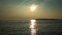 Fehmarn sunset boats returning from baltic sea Stock Footage