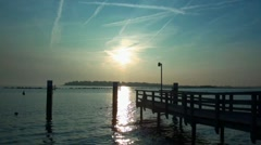 Fehmarn sunset relax with boat at small dock Stock Footage