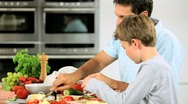 Caucasian Family Preparing Healthy Meal Together Stock Footage