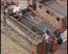 Bricklayers working in a roof of a house under construction. Stock Footage