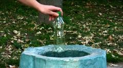 Plastic bottle and waste bin - stock footage