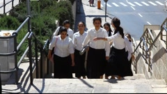 Jewish school girls on their way to the western wall Stock Footage
