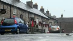 Traffic in Rain in Castleton in The Peak District, UK - stock footage