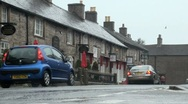 Stock Video Footage of Traffic in Rain in Castleton in The Peak District, UK