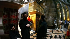 Church of the Holy Sepulchre: Priests talking - stock footage