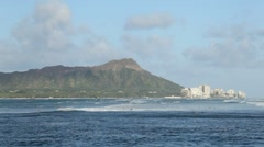 Diamond Head and surfers, Waikiki, Oahu, Hawaii Stock Footage