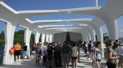 Tourists visiting USS Arizona Memorial, Pearl Harbor, Hawaii Stock Footage