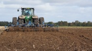 Tractor at work, farm field Stock Footage