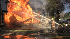 Hoses, firefighters and fire - stock footage