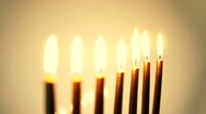 HD - Moving the focus on candles. Gold backgrounds Stock Footage