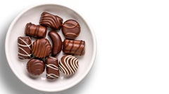 Chocolate candies in a dish Stock Footage