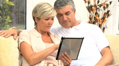 Mature Caucasian Couple Using Online Webchat at Home Stock Footage