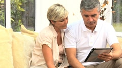 Mature Couple Needing Financial Solutions - stock footage