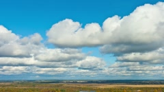 Clouds over the plain - stock footage