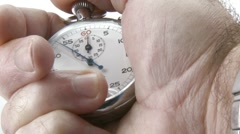 Stopwatch in hand counting the time Stock Footage