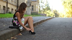 The beautiful girl cleans legs in the street Stock Footage