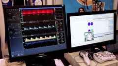 Monitors with diagrams Stock Footage