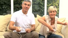 Mature Couple Playing on Home Games Console Stock Footage