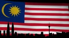 Kuala Lumpur skyline with rippling Malaysian Flag animation Stock Footage