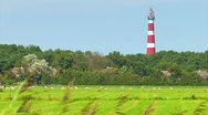 Red and white striped lighthouse Stock Footage