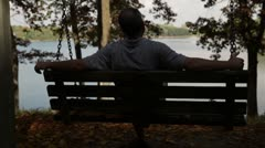 Man relaxes at Lake - stock footage