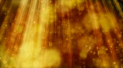 Seamless loop flying golden particles and blurs in light beams Stock Footage