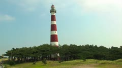 Red and white striped lighthouse - stock footage