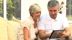 Mature Couple Having Success in Financial Planning - stock footage