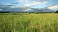 timelapse dark clouds above field. shot motorized slider. - stock footage
