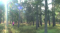 Woman walking in a forest Stock Footage