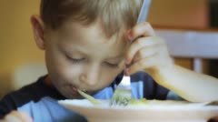 Little boy eating spaghetti. Stock Footage
