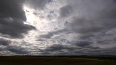 Storm clouds gathering over a field,passing right to left Stock Footage