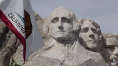 Mt. Rushmore and California state flag Stock Footage