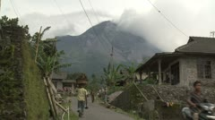 Merapi Volcano Towers Over Rural Village - stock footage
