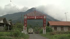 Merapi Volcano Towers Over Rural Village Stock Footage