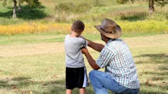 Father teaching son how to shoot a gun. Stock Footage