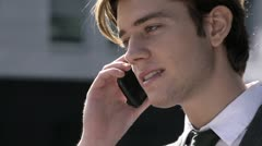 Young white collar worker speaking with mobile phone Stock Footage